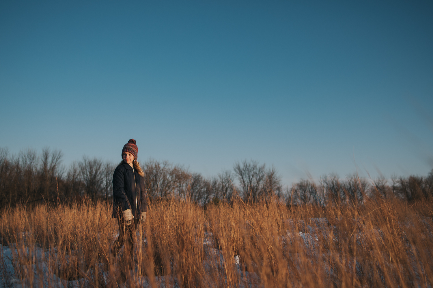 girl in golden field and dark blue sky - tween girl photography Orono, MN