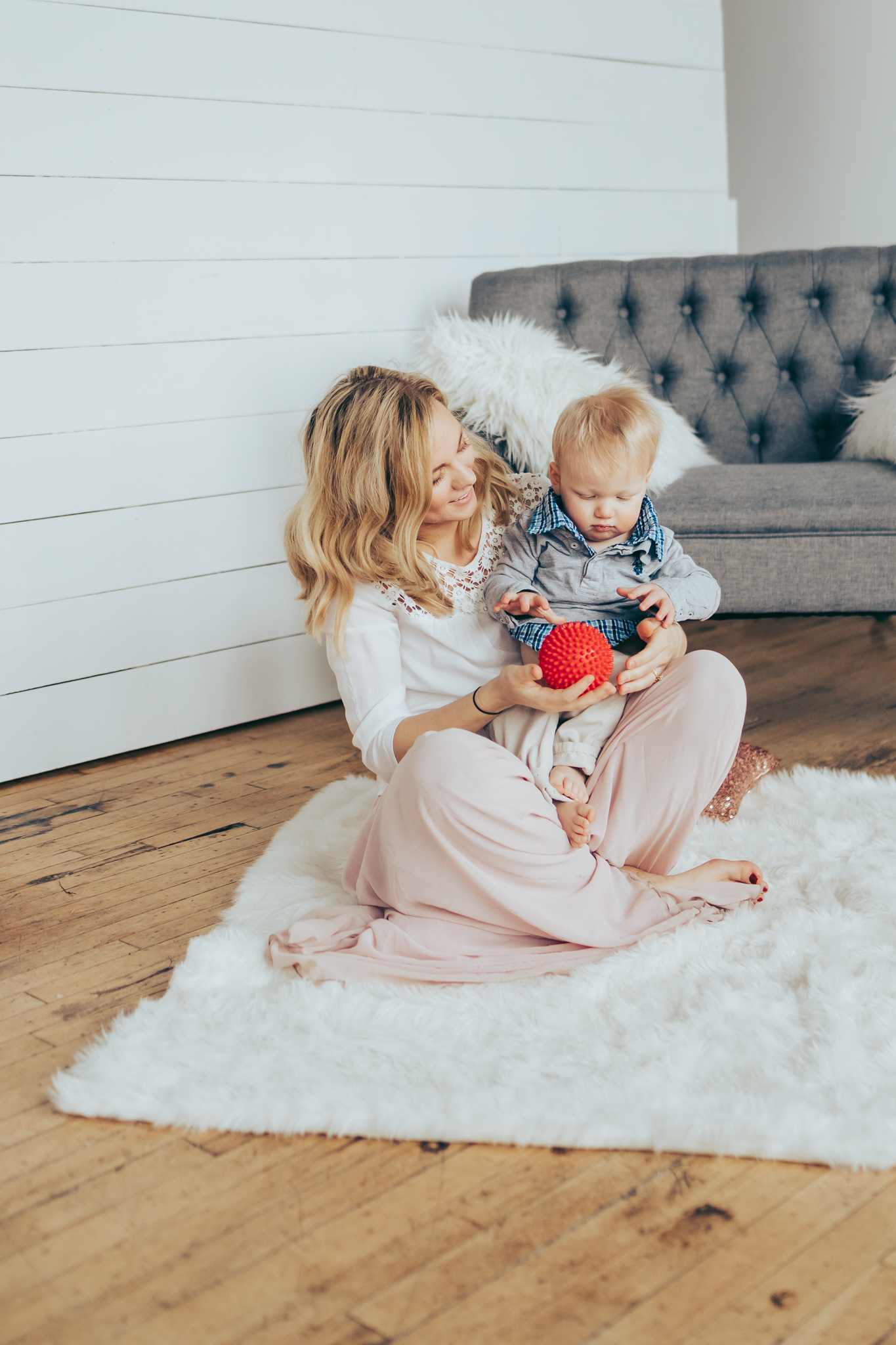 blonde woman holding baby boy - studio photographer