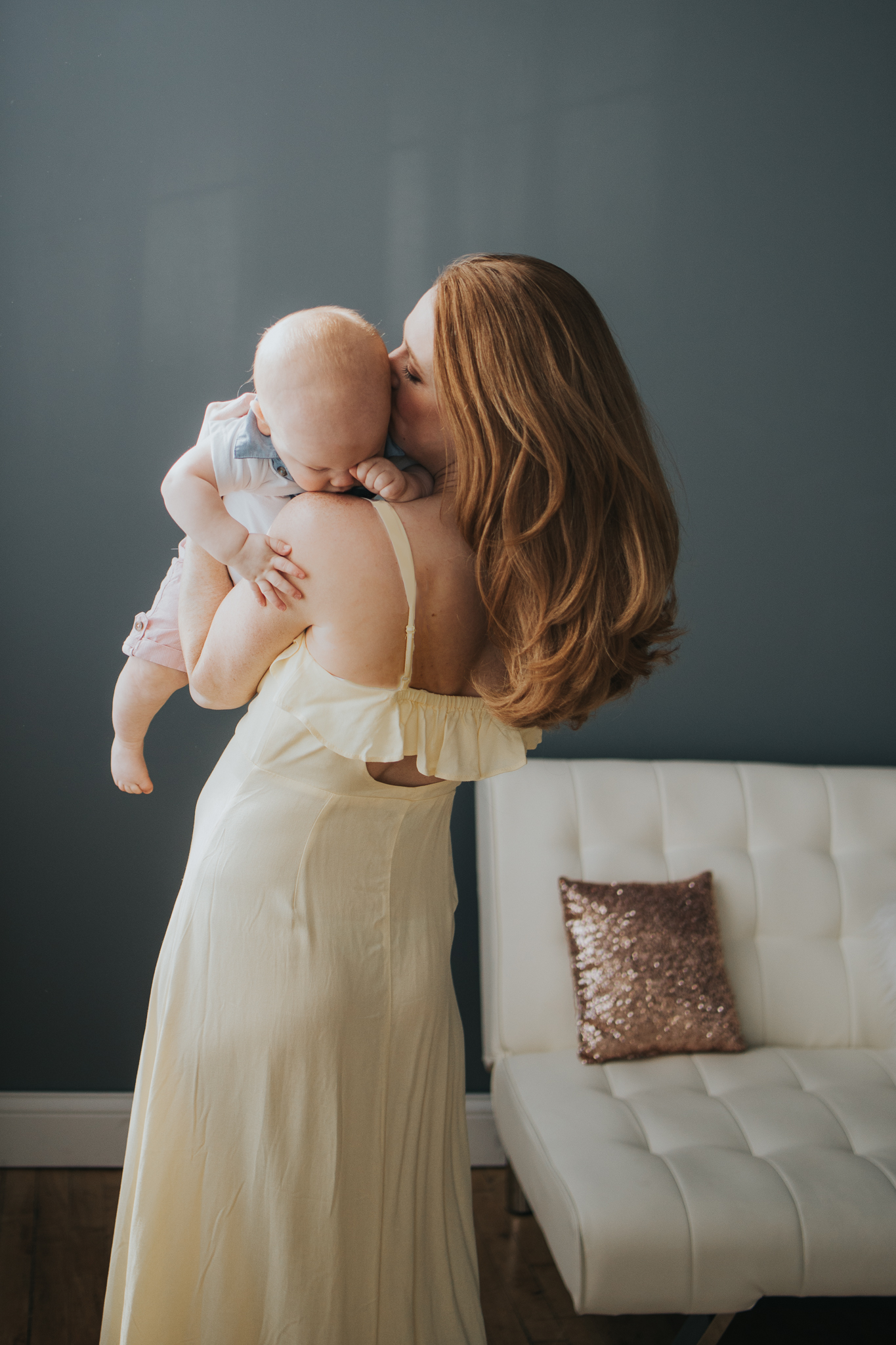 red haired mom in yellow dress snuggling with baby boy - AMG Photography