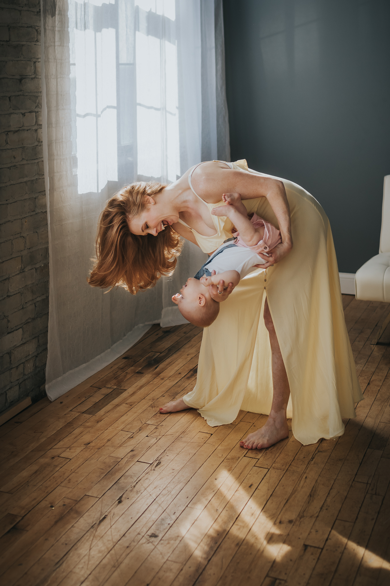 woman in yellow dress playing with little boy - Twin Cities Baby Photographer