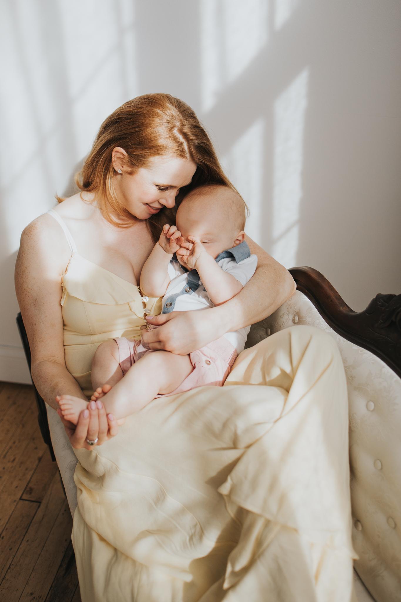 Baby sleeping on mommy's lap - Maple Grove Family Photographer