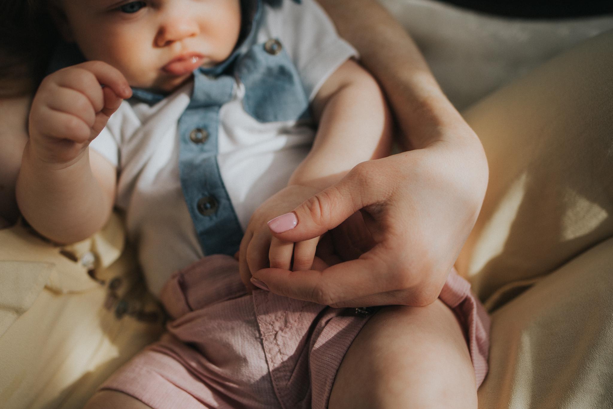 baby boy wearing blue - Minneapolis Newborn Photographer