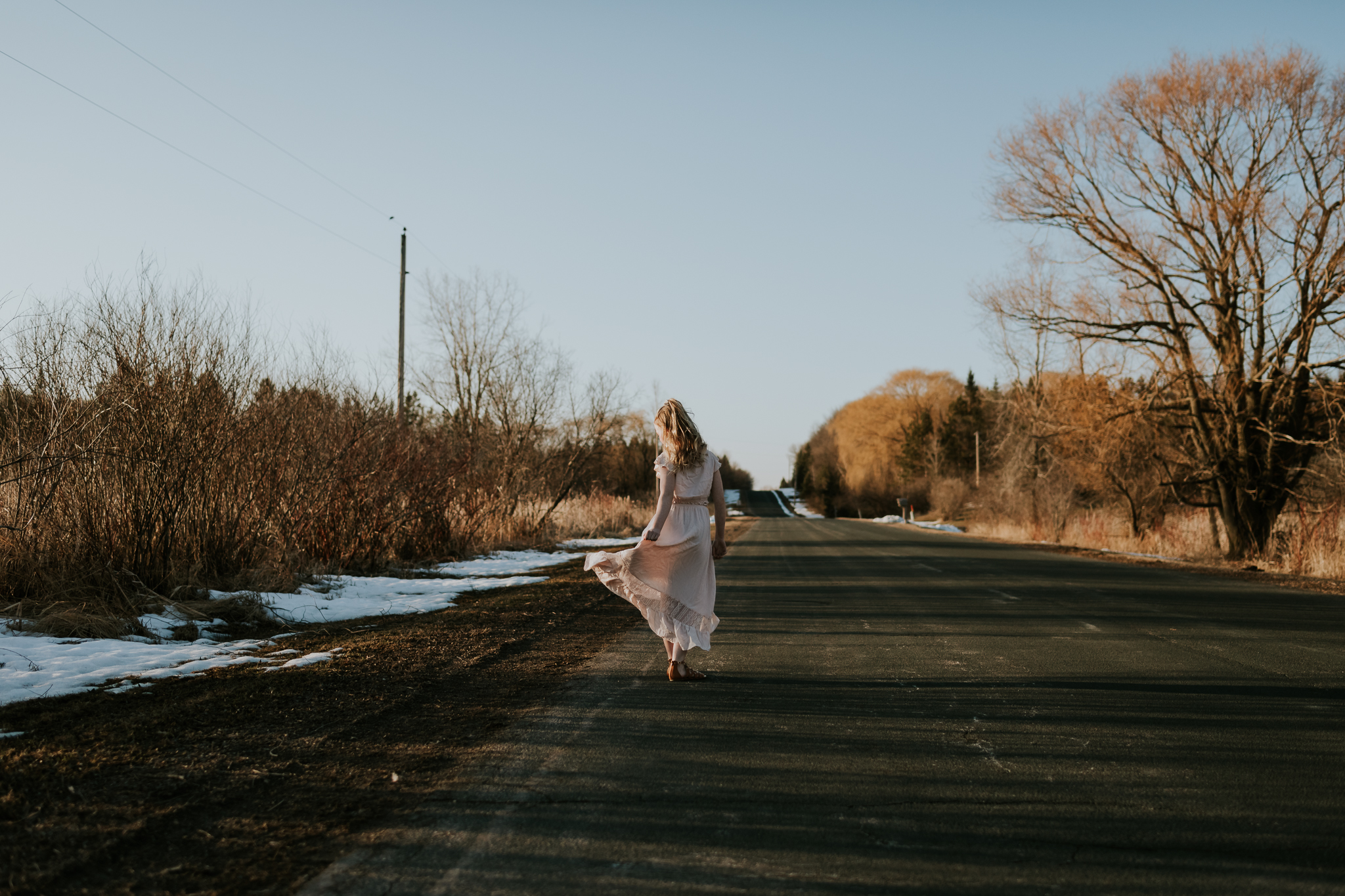 young girl walking down a country road - Minneapolis Family Photographer