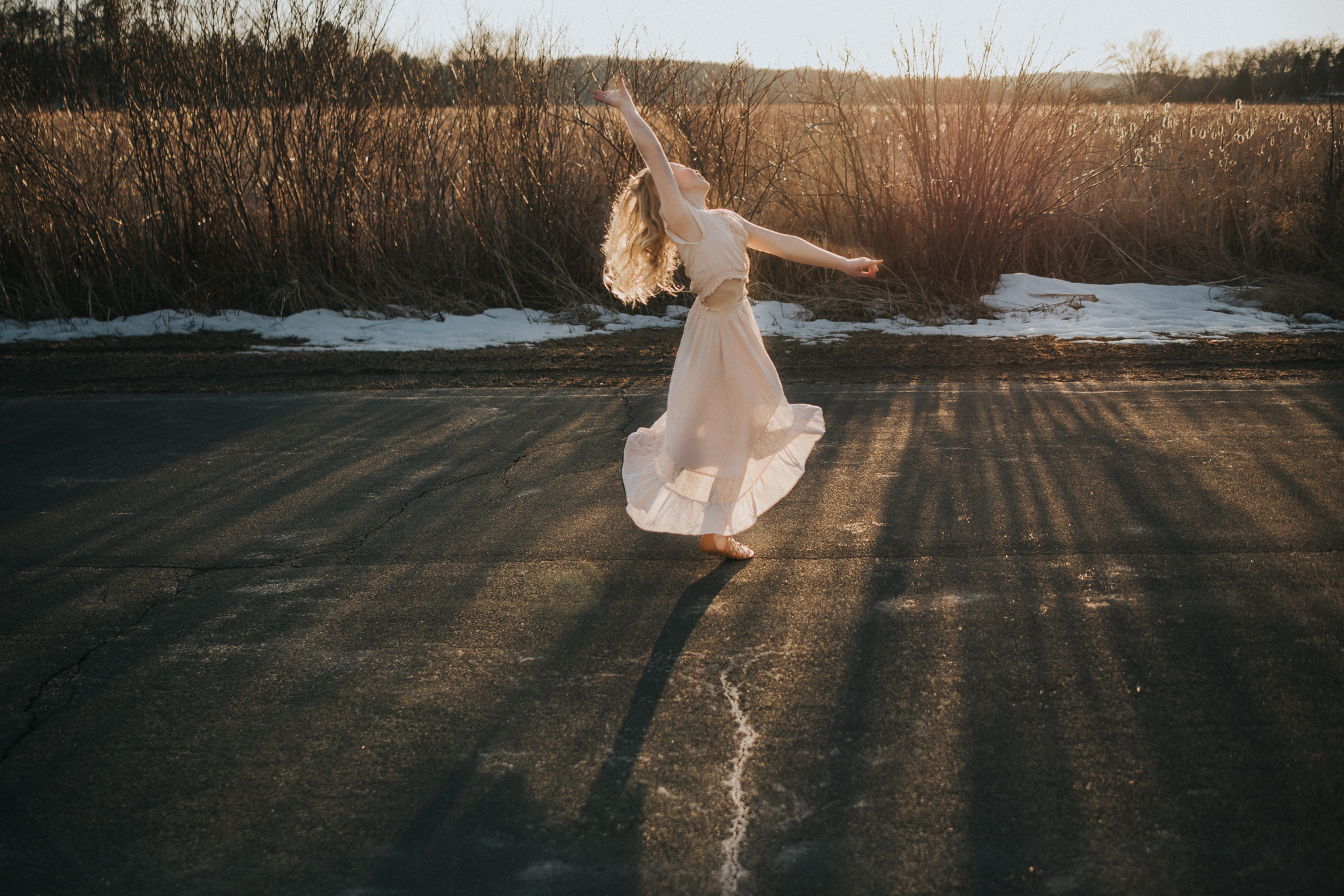 ballerina dancing in the sunlight on a country road - Minnesota Family Photographer