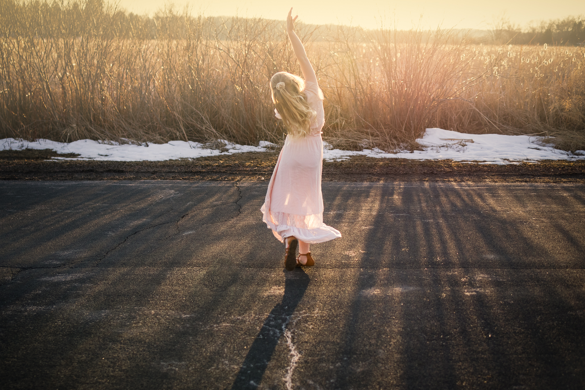 girl in pink dress dancing in the sunset - AMG Photography