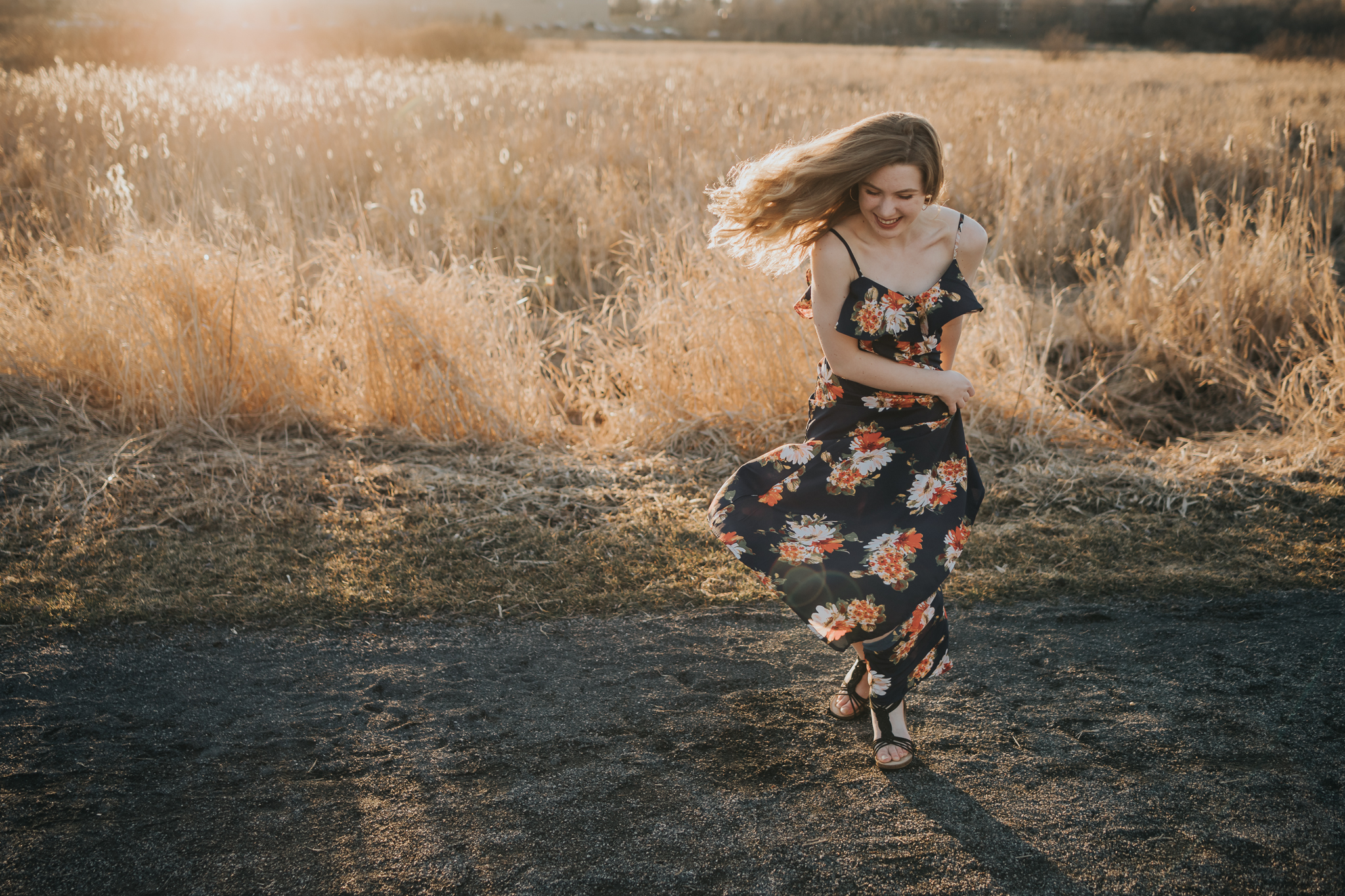teenage girl in blue dress with flower laughing - Wayzata Senior Photographer