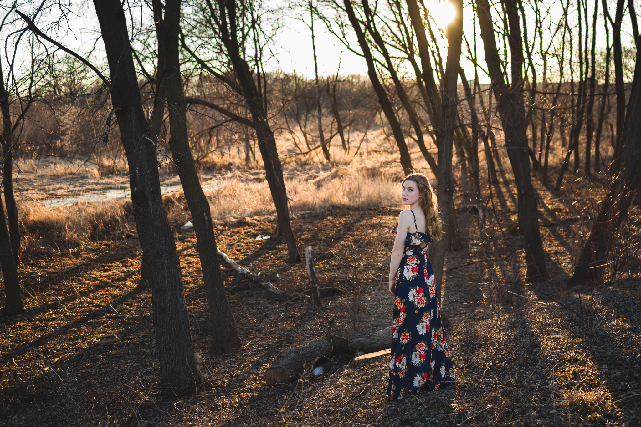 girl standing in the wood in blue dress - Orono Senior Photographer
