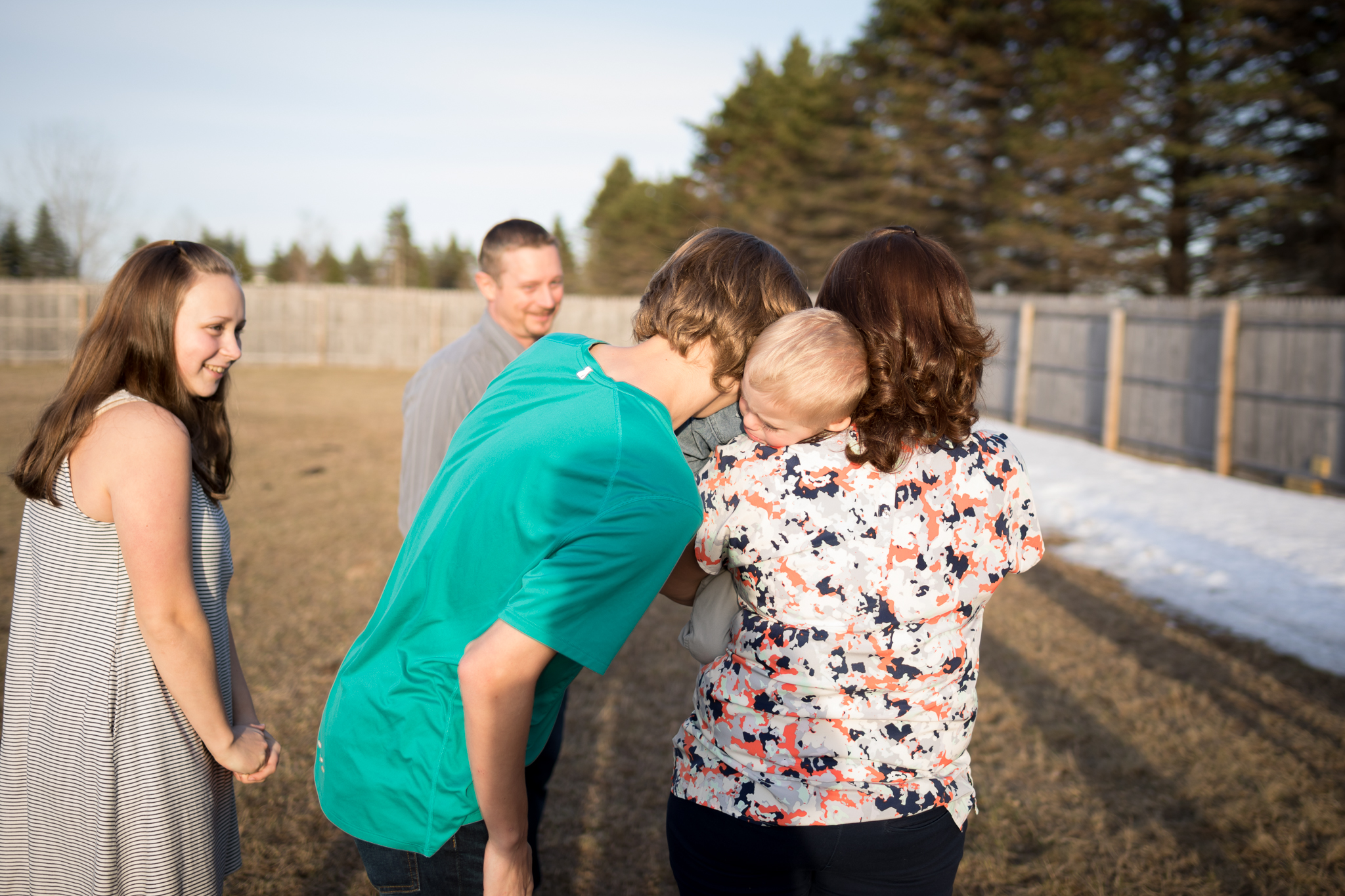 brother hugging little brother and mommy - Twin Cities Child Photographer