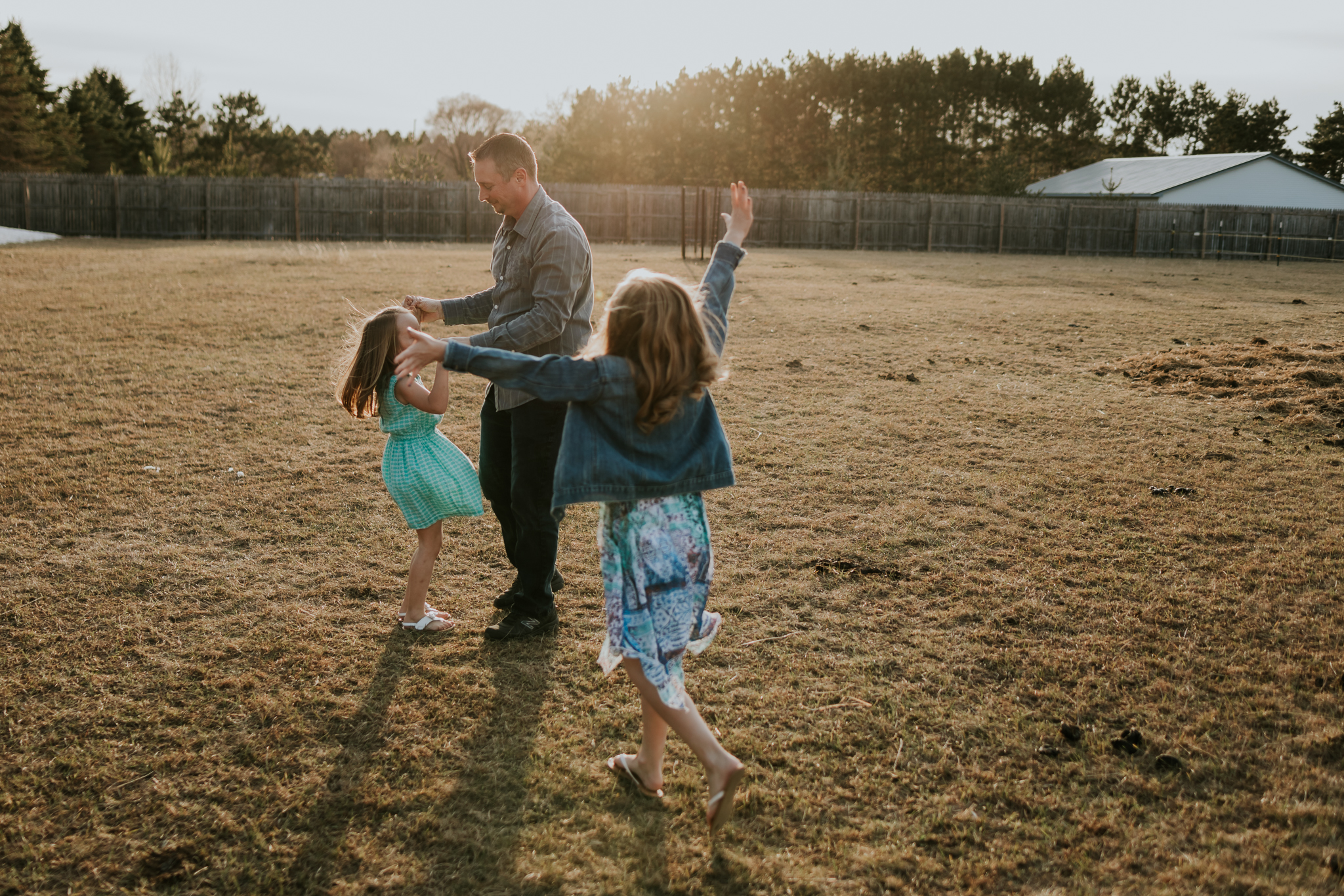 little girls dancing with daddy - Minneapolis Family Photographer