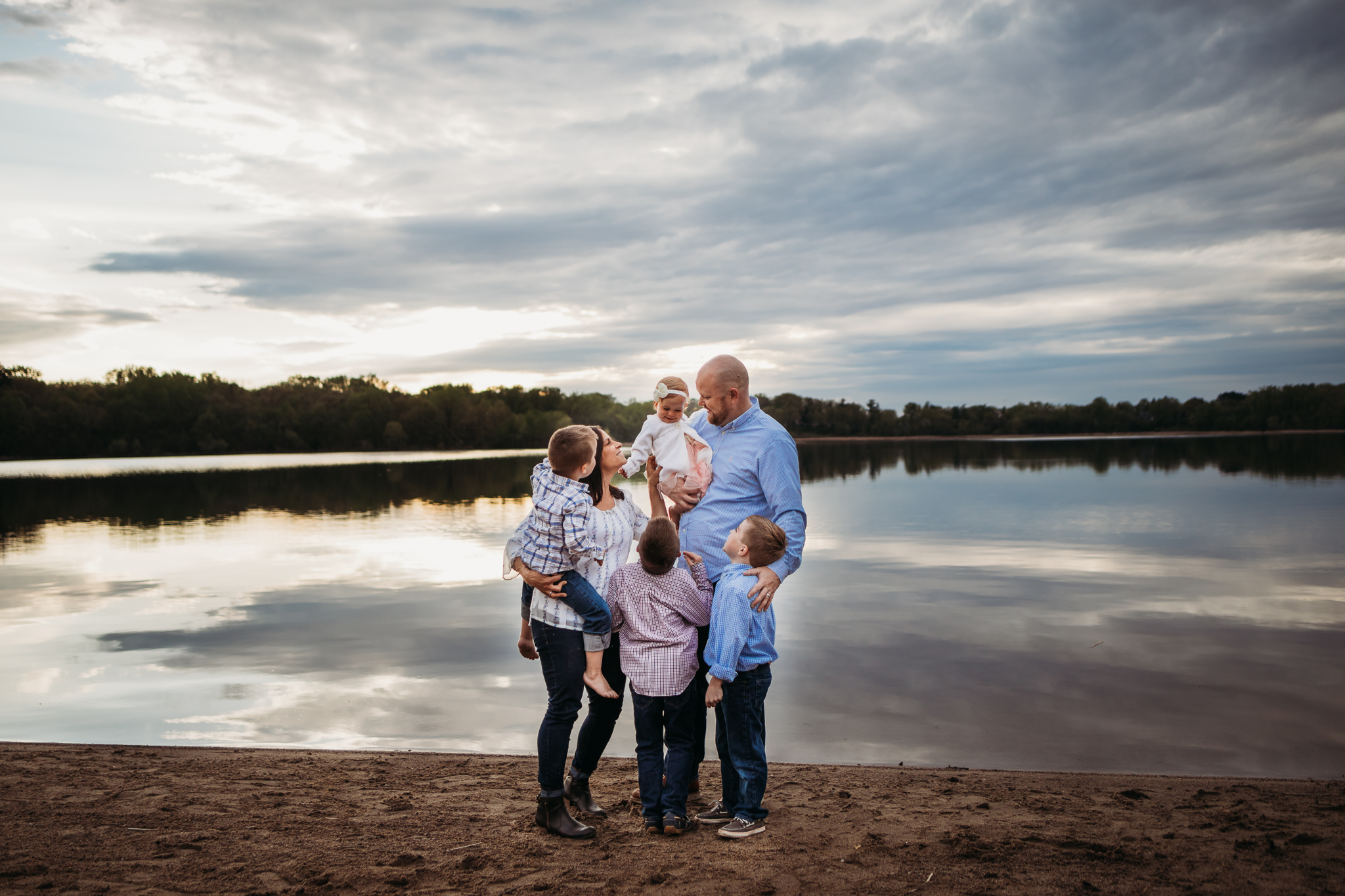 family of 5 standing by a lake  - AMG Photography