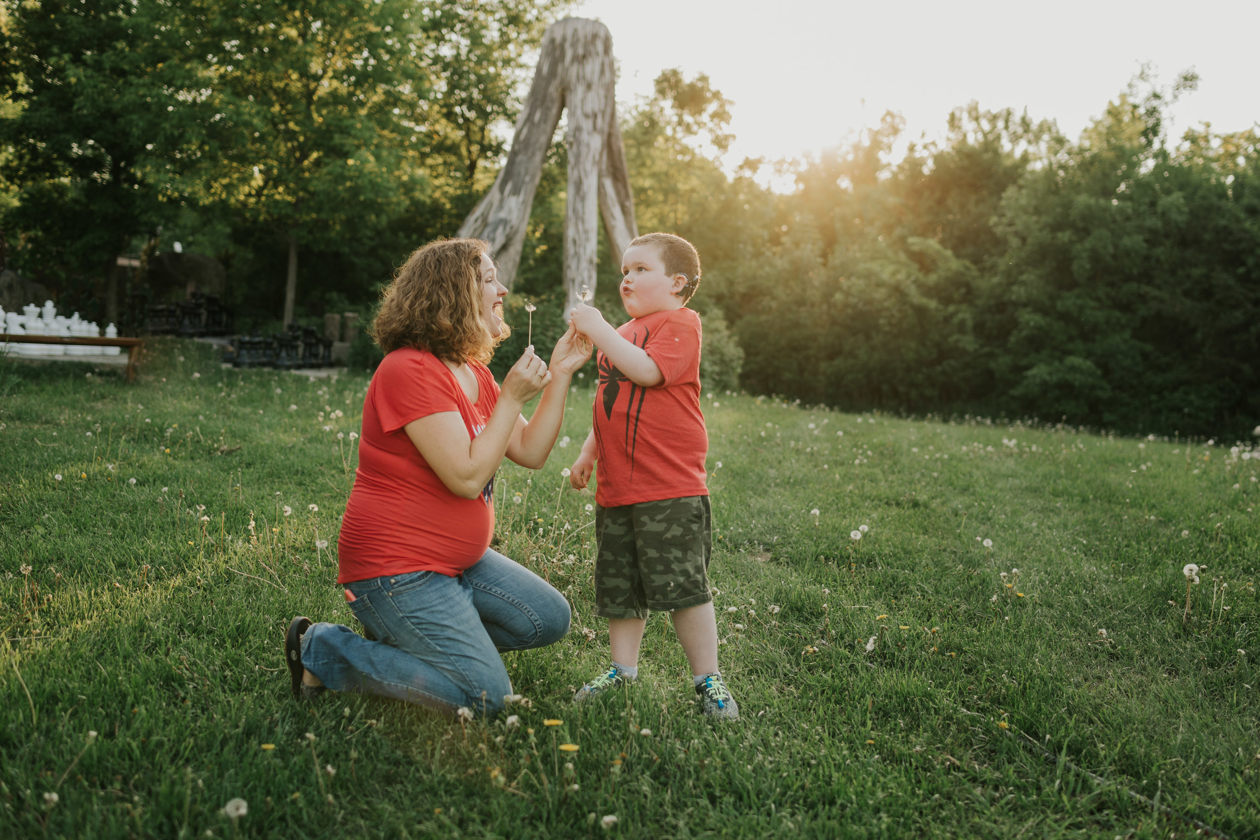 boy blowing dandelion flower seeds with mommy - Minneapolis Kid Photographer