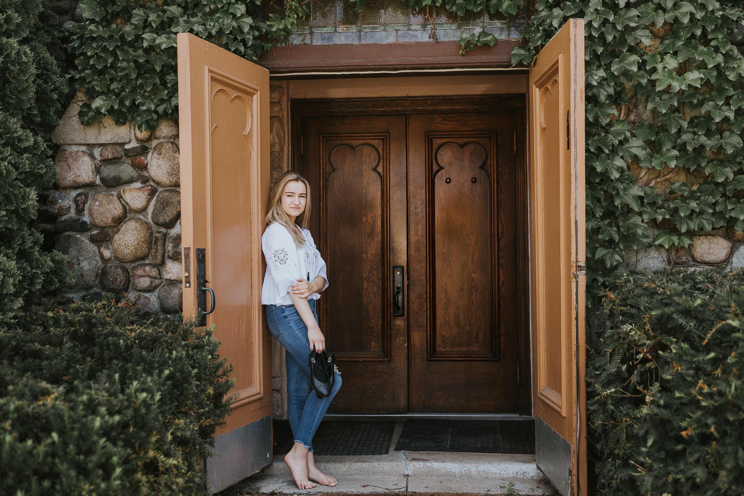 girl standing by old church door - Minneapolis Senior Photographer
