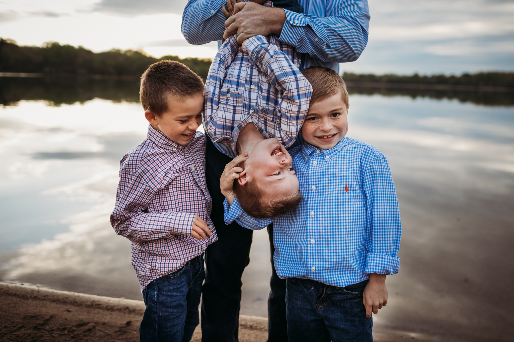 dad holding his three boys by a lake - Minneapolis Family Photographer