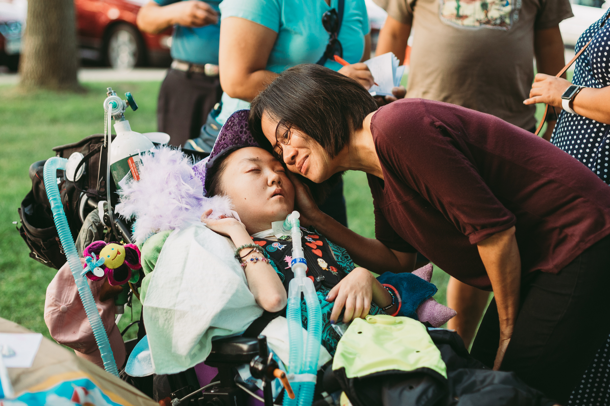 woman hugging girl in wheelchair - Minnesota Special Needs Photographer