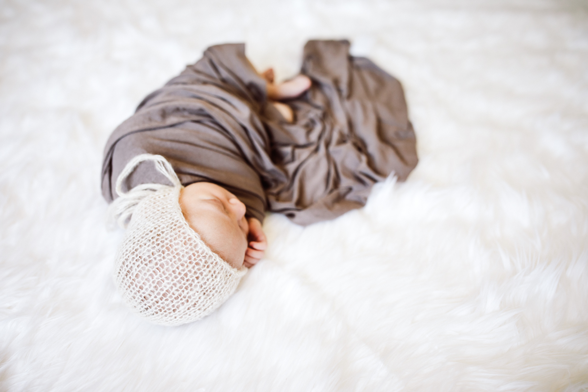 white bonnet on sleeping baby - Twin Cities Newborn Photographer