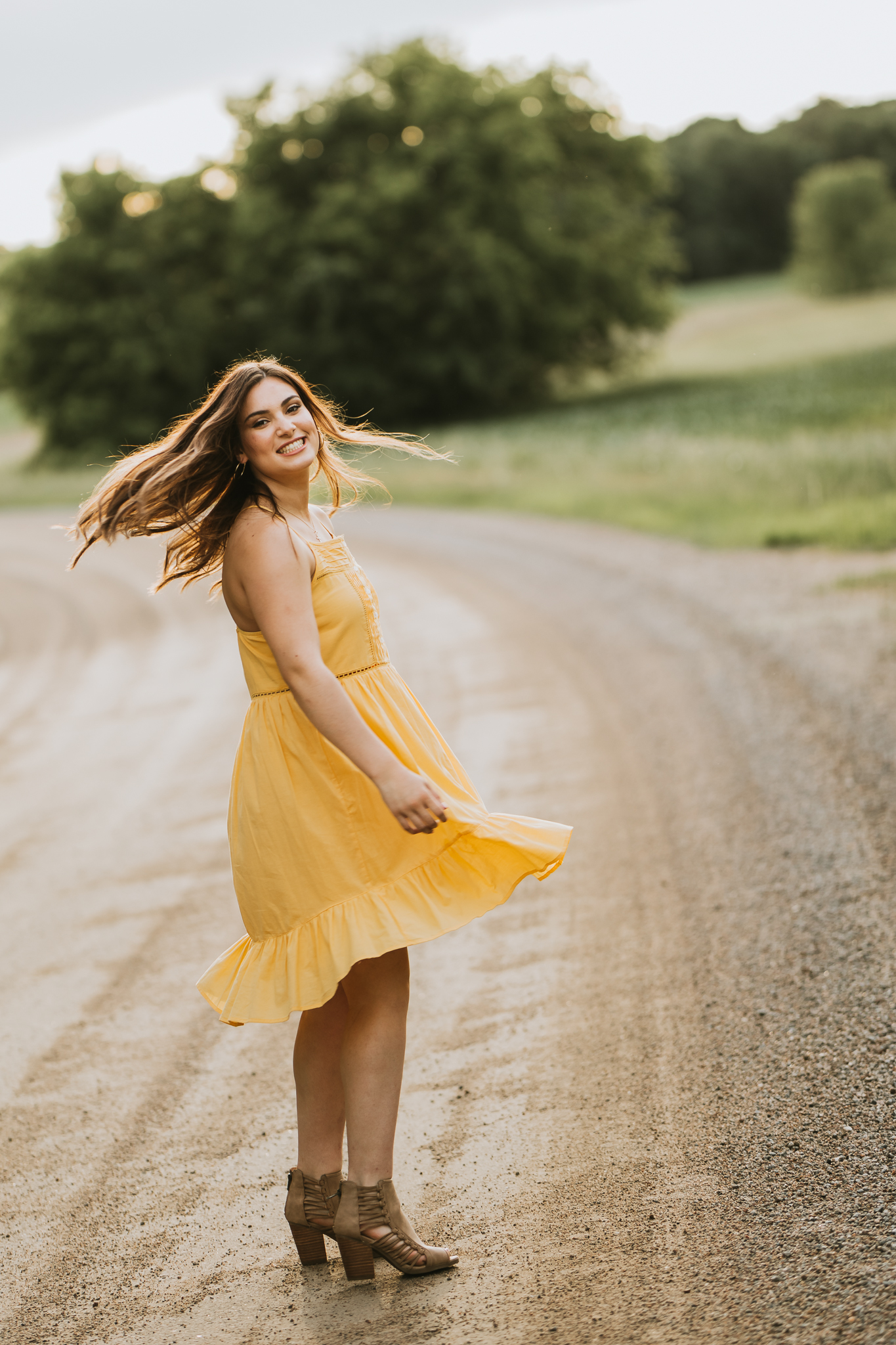 girl in a yellow dress on a country road - Eden Prairie Senior Photographer - AMG Photography