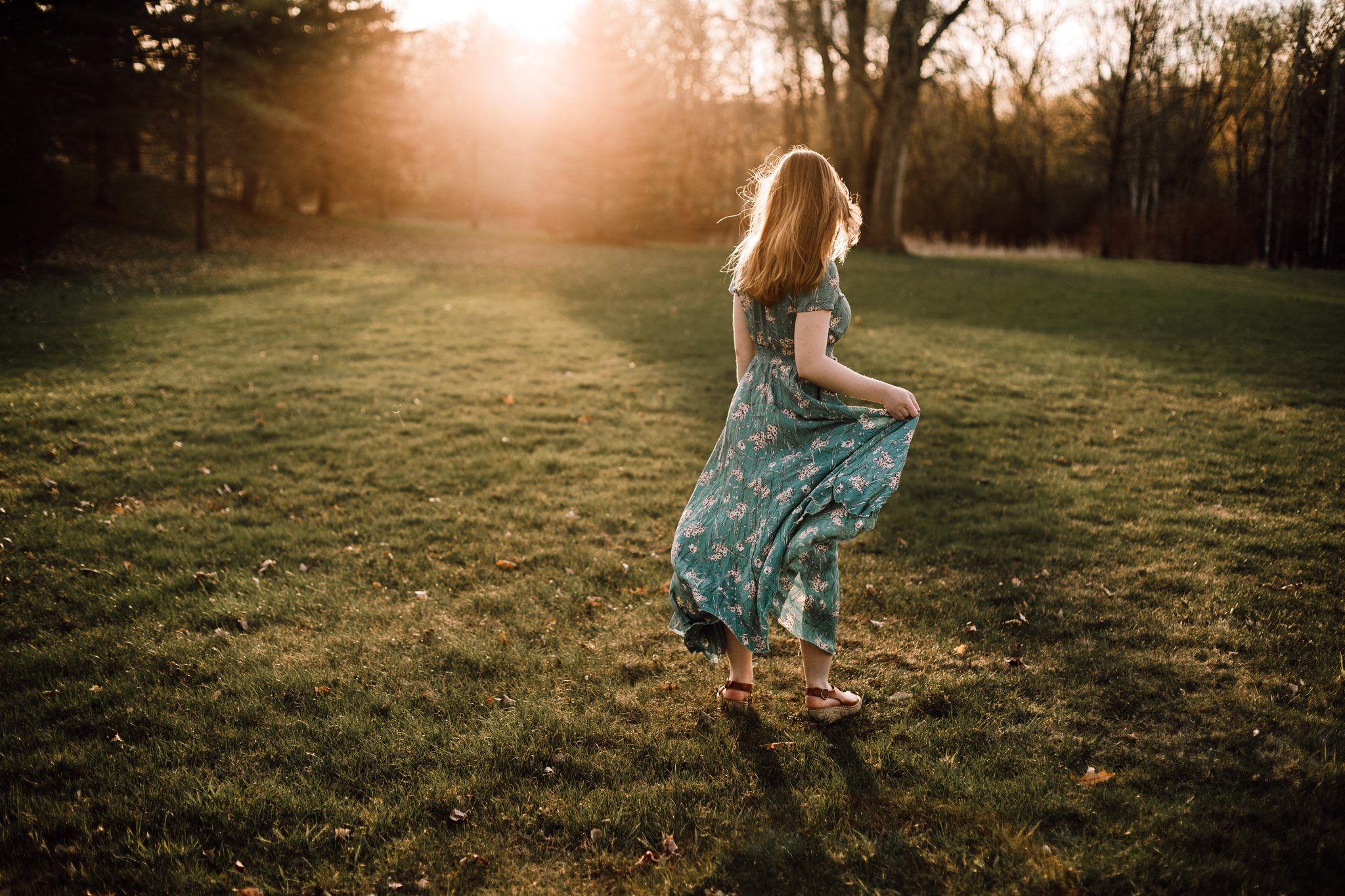 Woman in a field at sunset in a flowing dress - AMG Photography