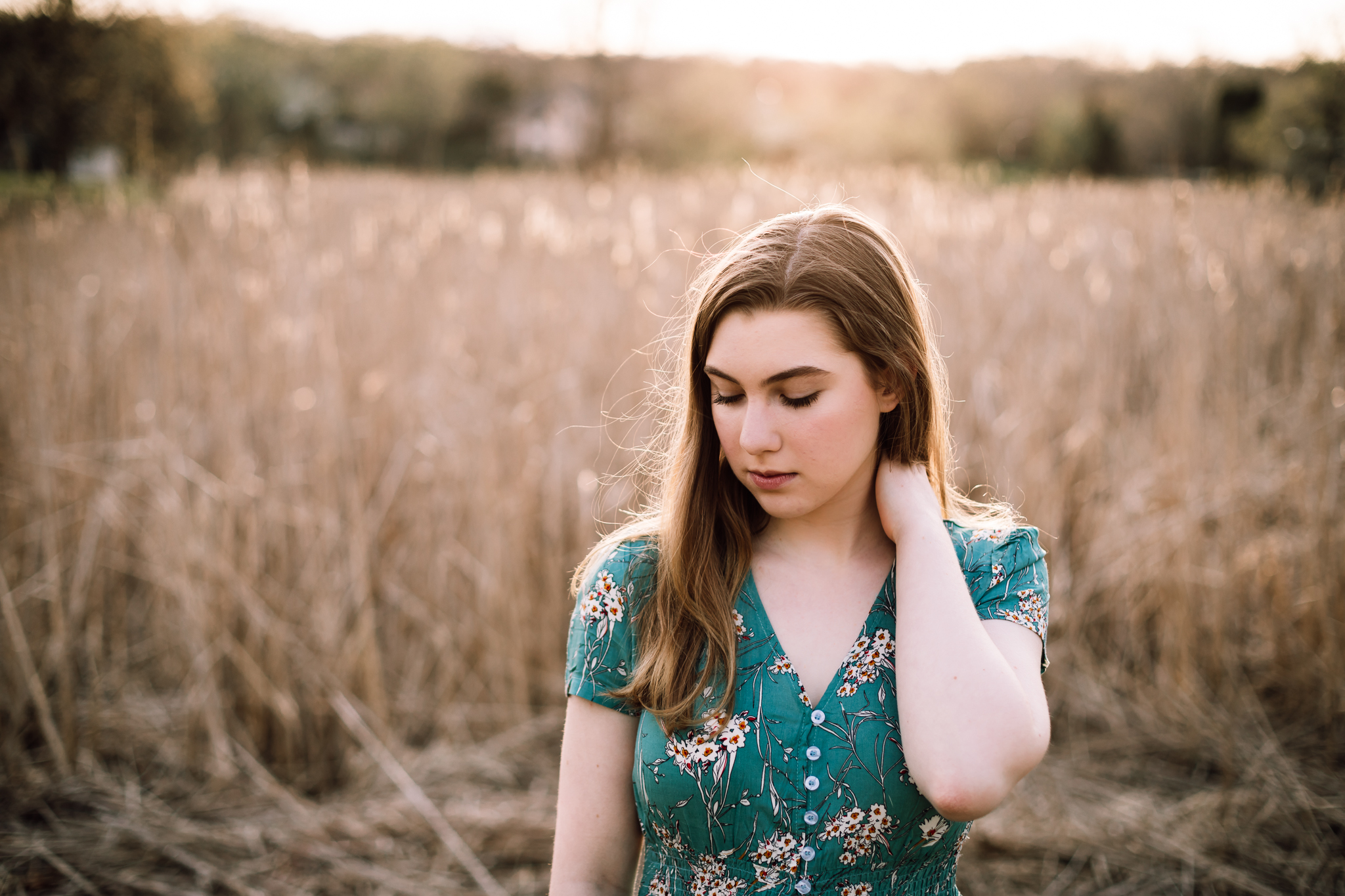 girl in blue dress with flowers standing in a field at sunset - AMG Photography