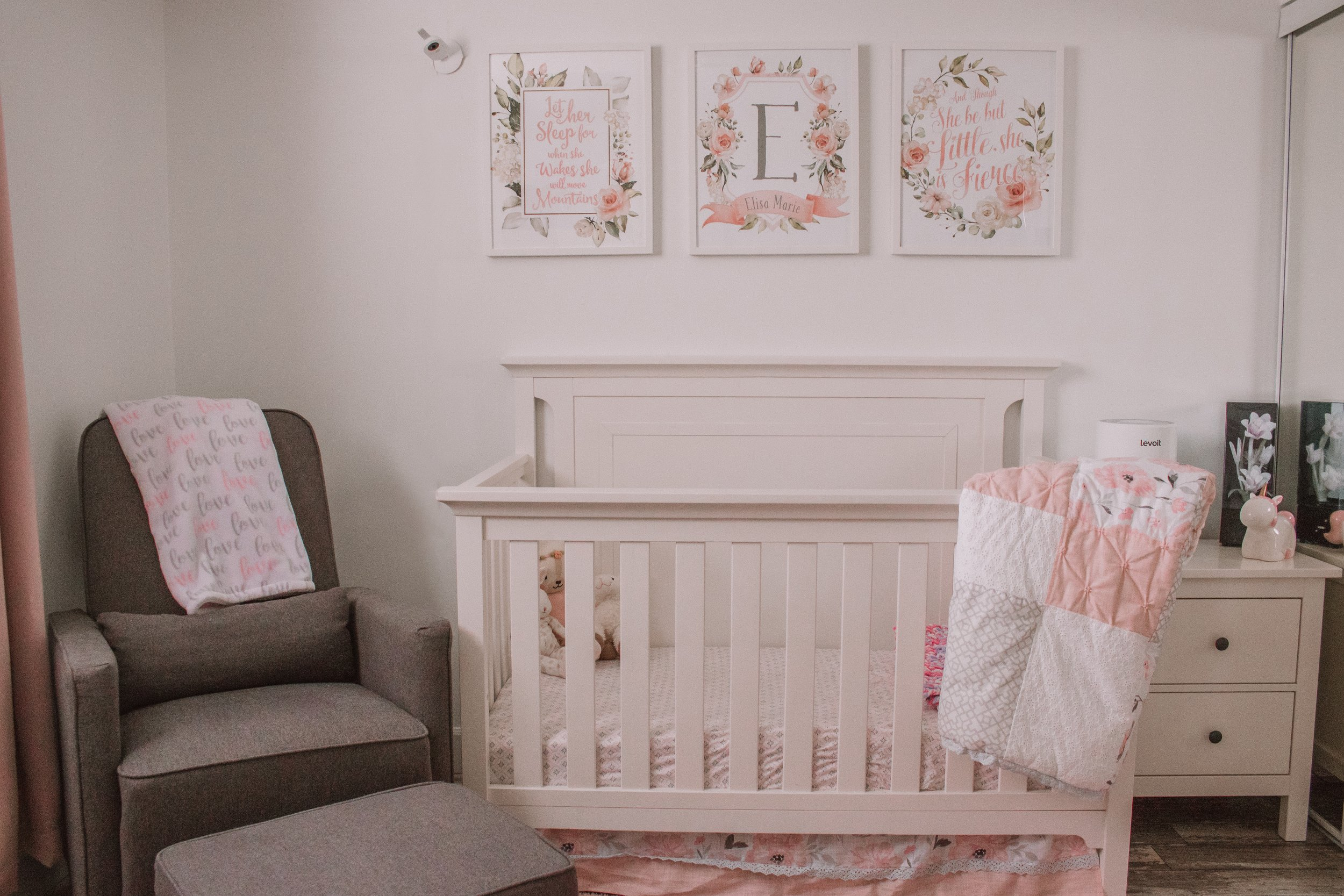 Since we live in a basement apartment, I kept the furniture and bedding light and bright. This helped make the space look and feel bigger.   Crib ,  Sheet Set ,  Bedding Set ,  Rocking Chair ,  Love Blanket ,  Photos above Crib