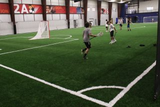 Indoor turf playing field is used for multiple sports, including, lacrosse and soccer.