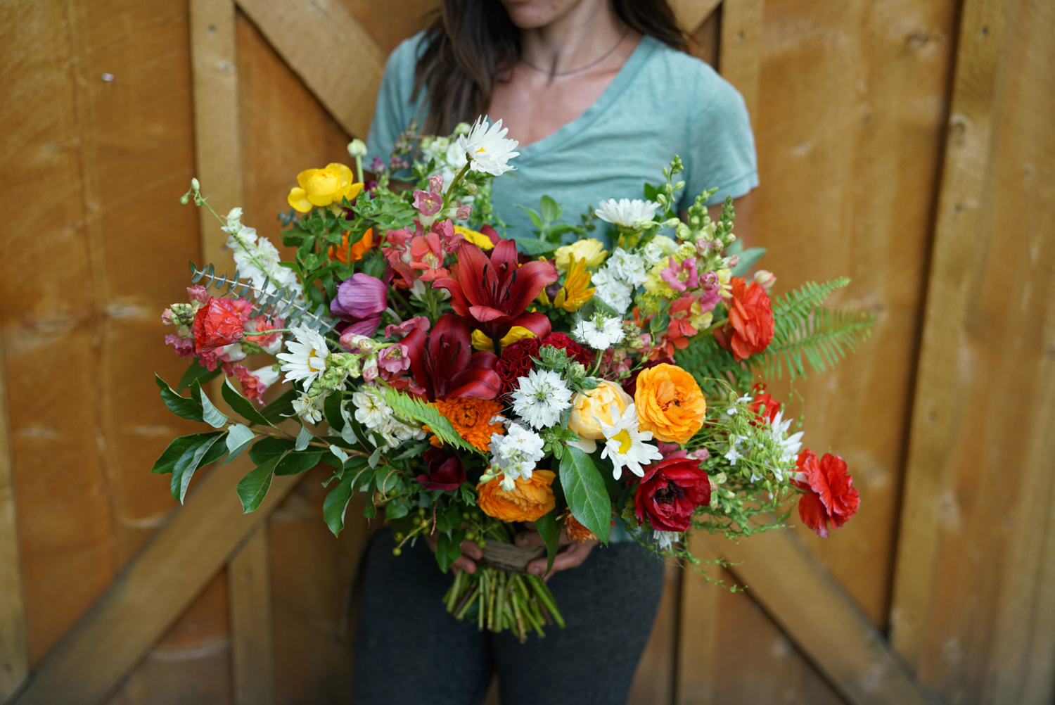 A super-fun June bouquet featuring ranunculus and lilies.  Image ©Nelson Esseveld.