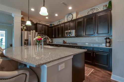 You'll be spending all of your time in this ornately defined gourmet kitchen, featuring an oversized granite island, double wall ovens, stainless steel appliances, farm sink, and so much more!