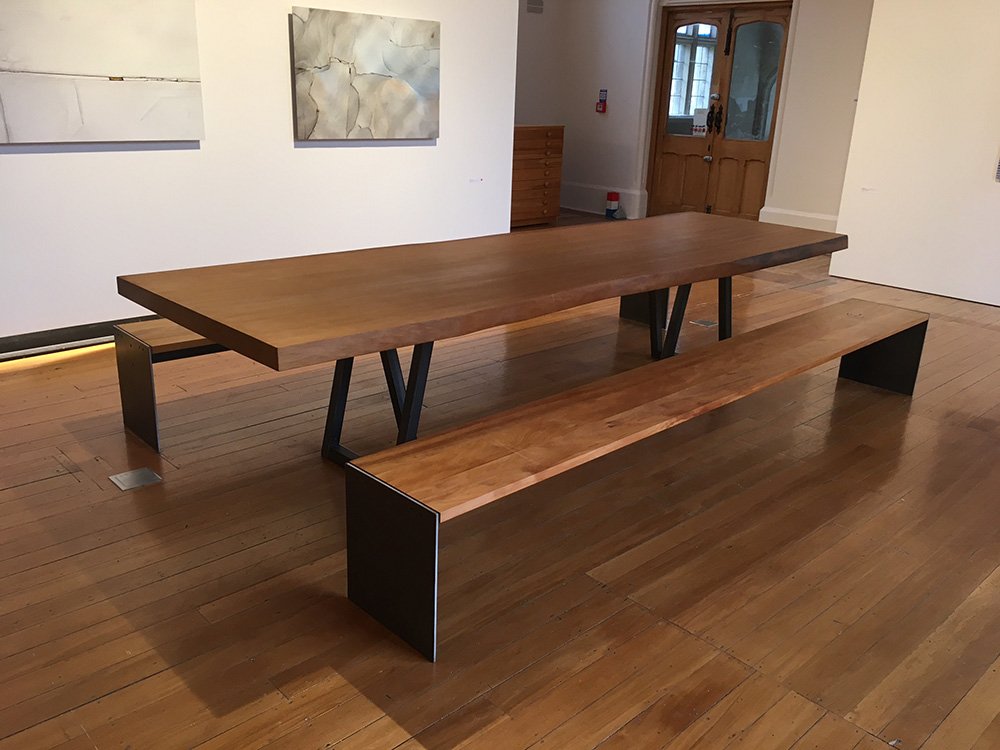 Umber Ancient Kauri Dining Table    - 40,000 year old ancient swamp kauri   ,    steel    Mica Bench Seat    - River rescued matai, aged steel