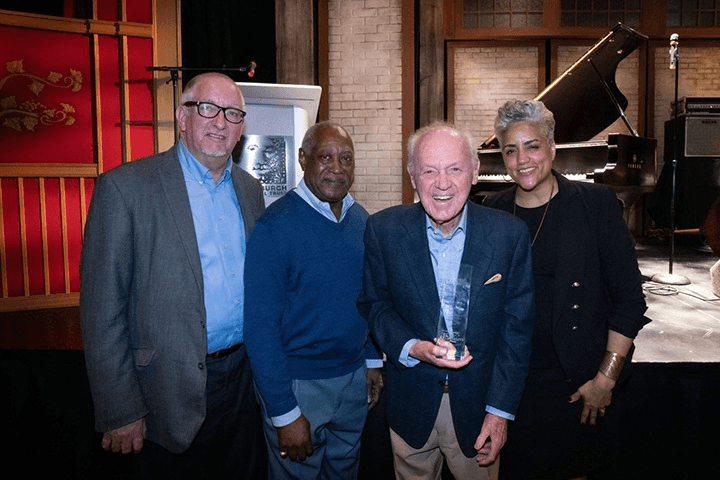 (From left to right) Max Leake, Roger Humphries, Joe Negri and Terri Bell following the presentation of Negri's award. Leake is the pianist in Roger's band and presented the award to Negri.