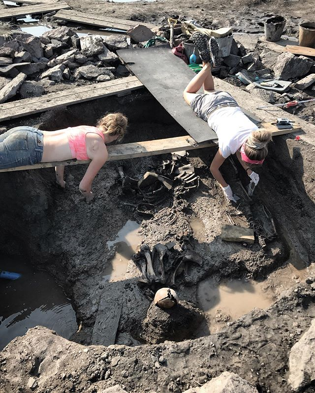 Here Dasha and Rita are cleaning out a medieval Turkic burial of a child and a horse interned together. After lots of stone removal, shoveling, and troweling this is one of the last steps in the excavation process. You can see they are suspended above the burial by boards because they need to keep the cultural layer clean. That means no footprints 👣! It takes a trained eye to see the change in color of the soil to know what is the original level of the burial and the freezing and thawing of Siberian soil layers makes it even harder. After it is clean we can get an idea of what it might have looked like when the person was buried and we go over it with a metal detector to make sure we didn't miss any artifacts. . . . . . . . Been getting more questions about the context of our excavation so this is to share one step of the process . . . . . . .#siberia #russia #tuva #archaeology #fieldwork #expedition #explorersclub #archaeologylife #anthropology #digging #worldwidewallace #nature #wilderness #optoutside #ancient #burial #mosquitos #mosquitobites #kurgan #tunnug #science #research