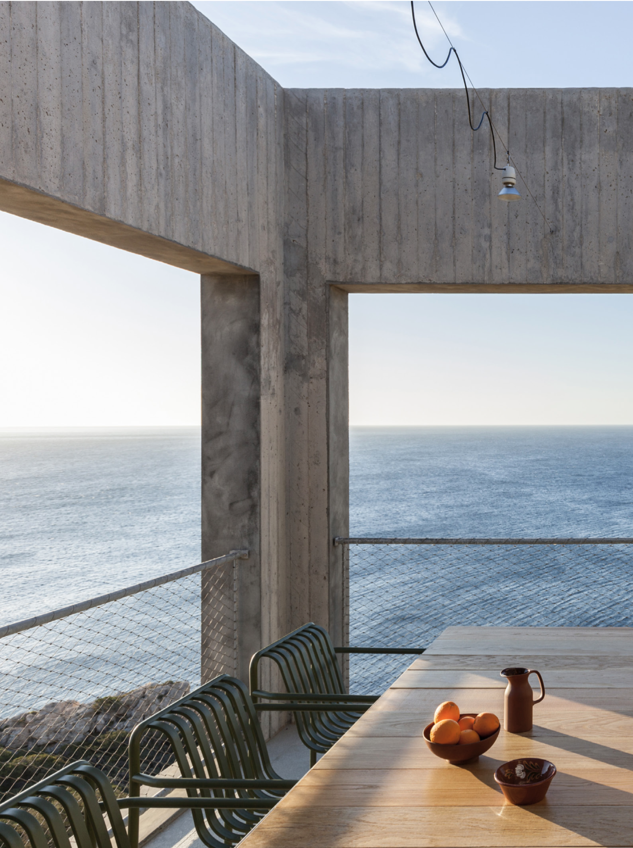 The landscape emerging from the south-eastern Aegean sea in Karpathos, Greece is wild and untamed and yet it's here, among jagged rock and wind-battered brush that a Paris-based couple decided to lay down their roots with Patio House. -
