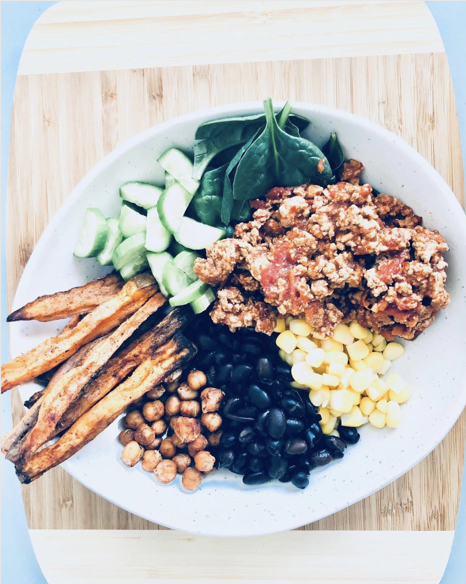 - Ingredients450gram of Lean Turkey Mince (swap for fish if don't eat turkey) 1 clove garlic, minced ½ small brown onion, peeled and finely chopped 1 tbsp olive oil Taco Seasoning1 tbsp chili powder¼ tsp garlic powder ¼ tsp onion powder ¼ tsp dried oregano1 ½ tsp ground cumin 1 tsp table salt 1 tsp ground black pepper Cauliflower Rice - Recipe hereMethodIn a large skillet add garlic, onion and oil. Bring pan to medium high heat. Stir and cook until onions are halfway done and aroma of the garlic has been released. Add in turkey mince and cook until browned. Add in taco seasoning and 1/4 cup of water (you may need to add more). Stir the seasoning into the turkey mixture and cook until turkey is completely cooked. Then to the FUN PART adding your greens/veggies! My faves: grated carrot & zucchini, sliced beetroot, black beans (make sure you soak and rinse!!! These need to be properly prepared and only use if you can tolerate them as they can be very irritating to the gut lining), Organic Non GMO corn (you can buy from organic grocery), spinach, diced avocado, coriander, sauerkraut!