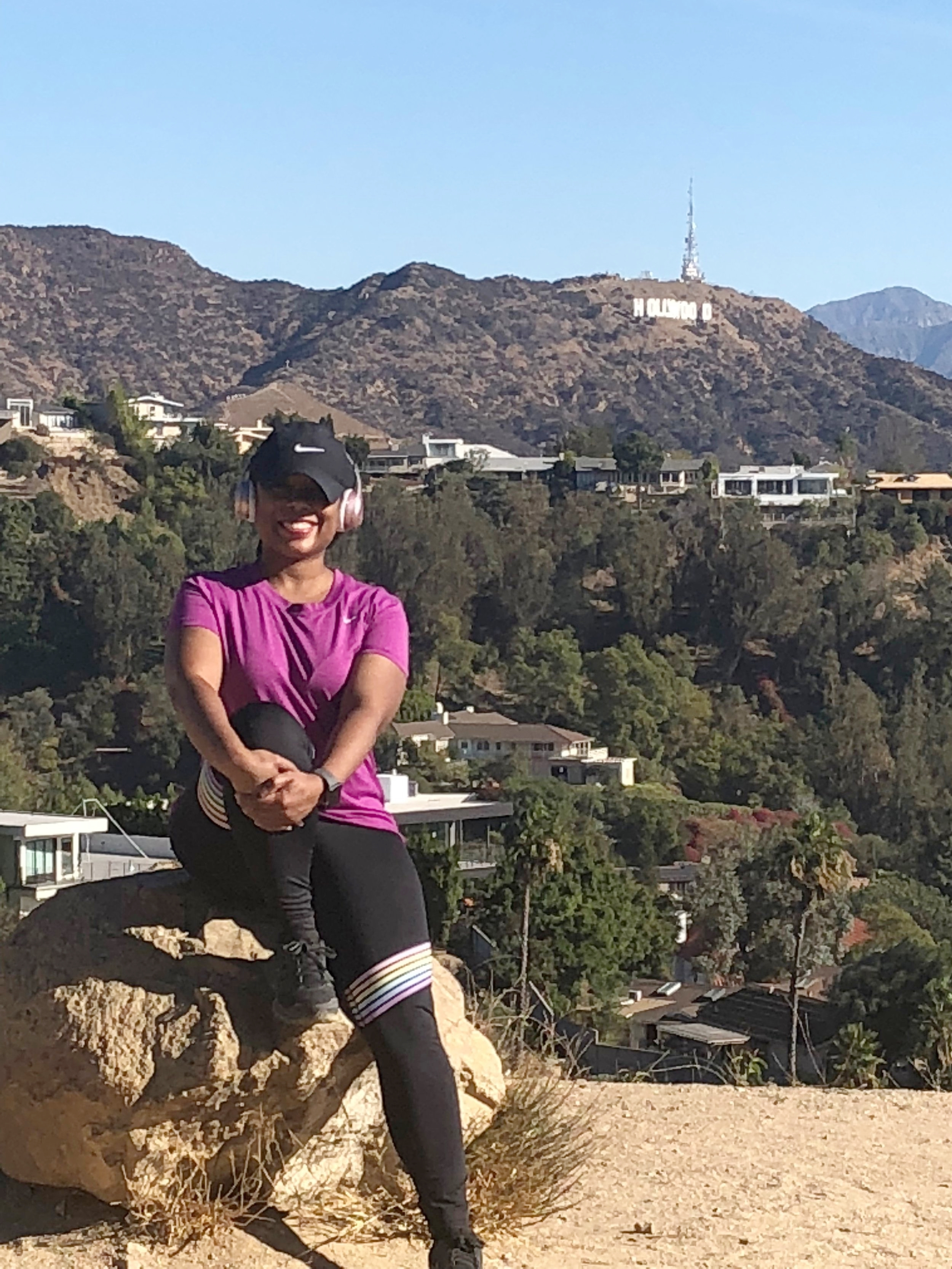 I am smiling because I was finally able to rest. Lol! We hiked over 8 miles and I was beat. Those hills were no joke!