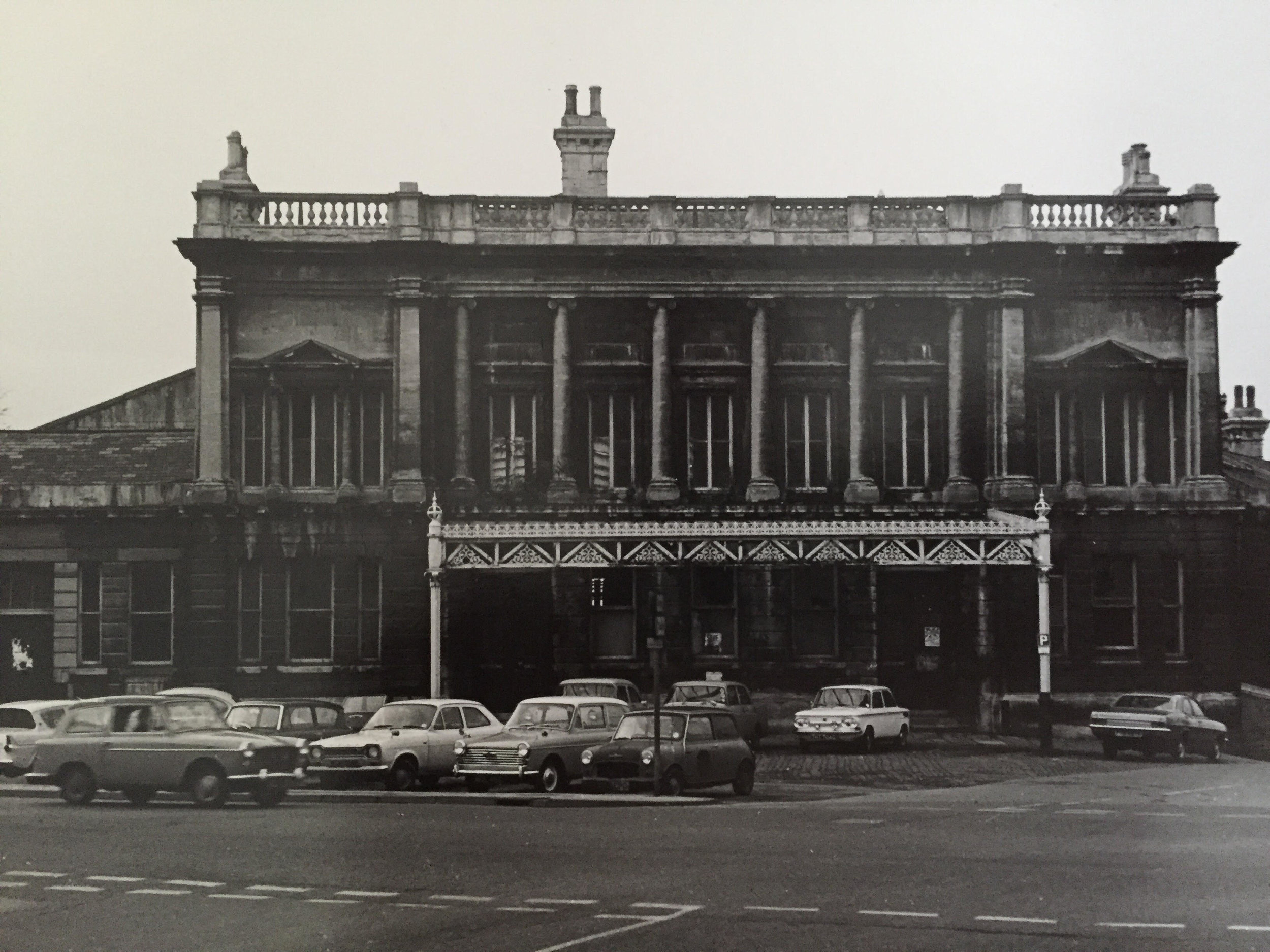 The front of Green Park Station in Bath after the station was decommissioned. The original cobbled front pavings remains today, but the road space has been reconfigured with parking only at the rear of the building in the former station.