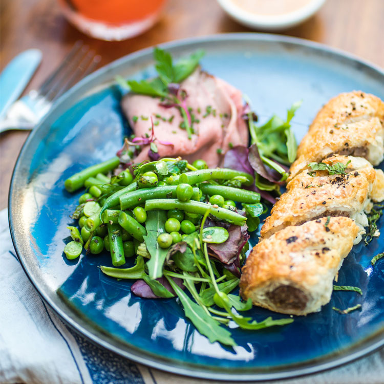 Somerset Pork & Sage Sausage Roll, Pea, Mint & Bean Salad with leaves and Newton Farm Beef