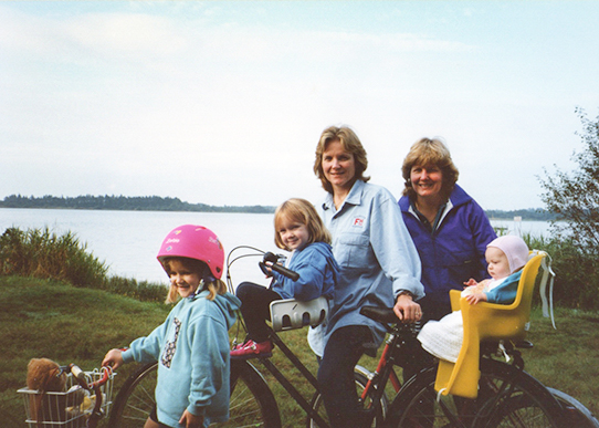 Jesse with her family [she is the one in the fetching pink barbie helmet]