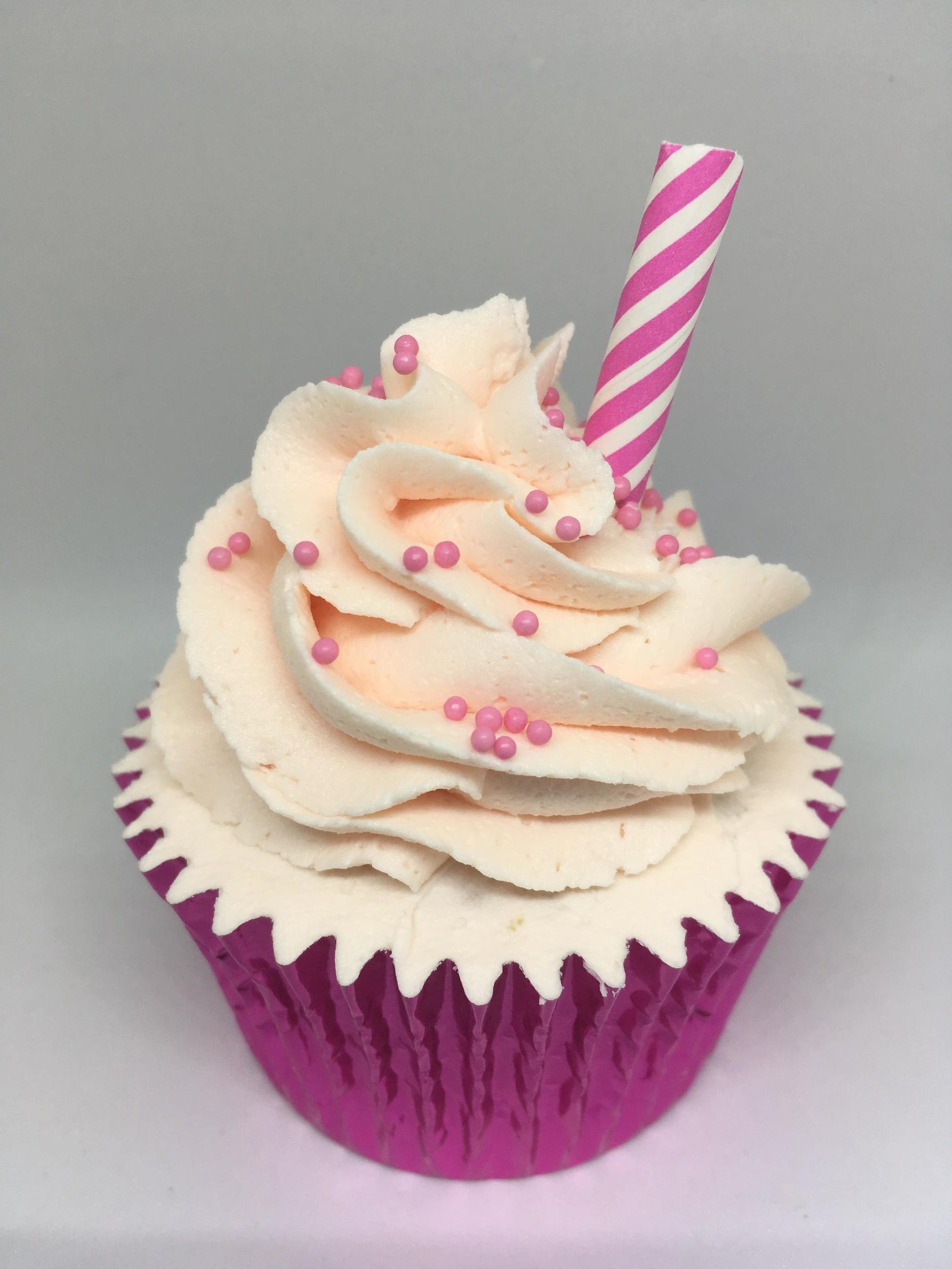 Strawberry Milkshake - A vanilla cupcake filled with strawberrry jam and topped with strawberry Milkshake flavoured buttercream
