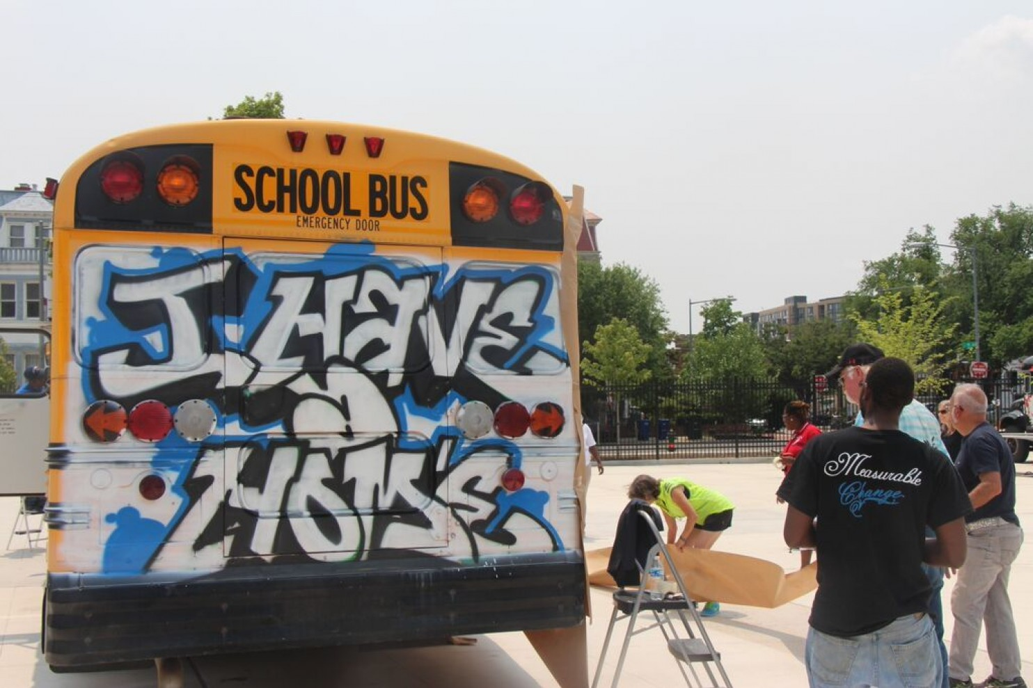 """The Street Sense """"I Have A Home Here"""" art bus outside of DC's Dunbar High School in June 2015. Mark Jenkins/The Washington Post."""