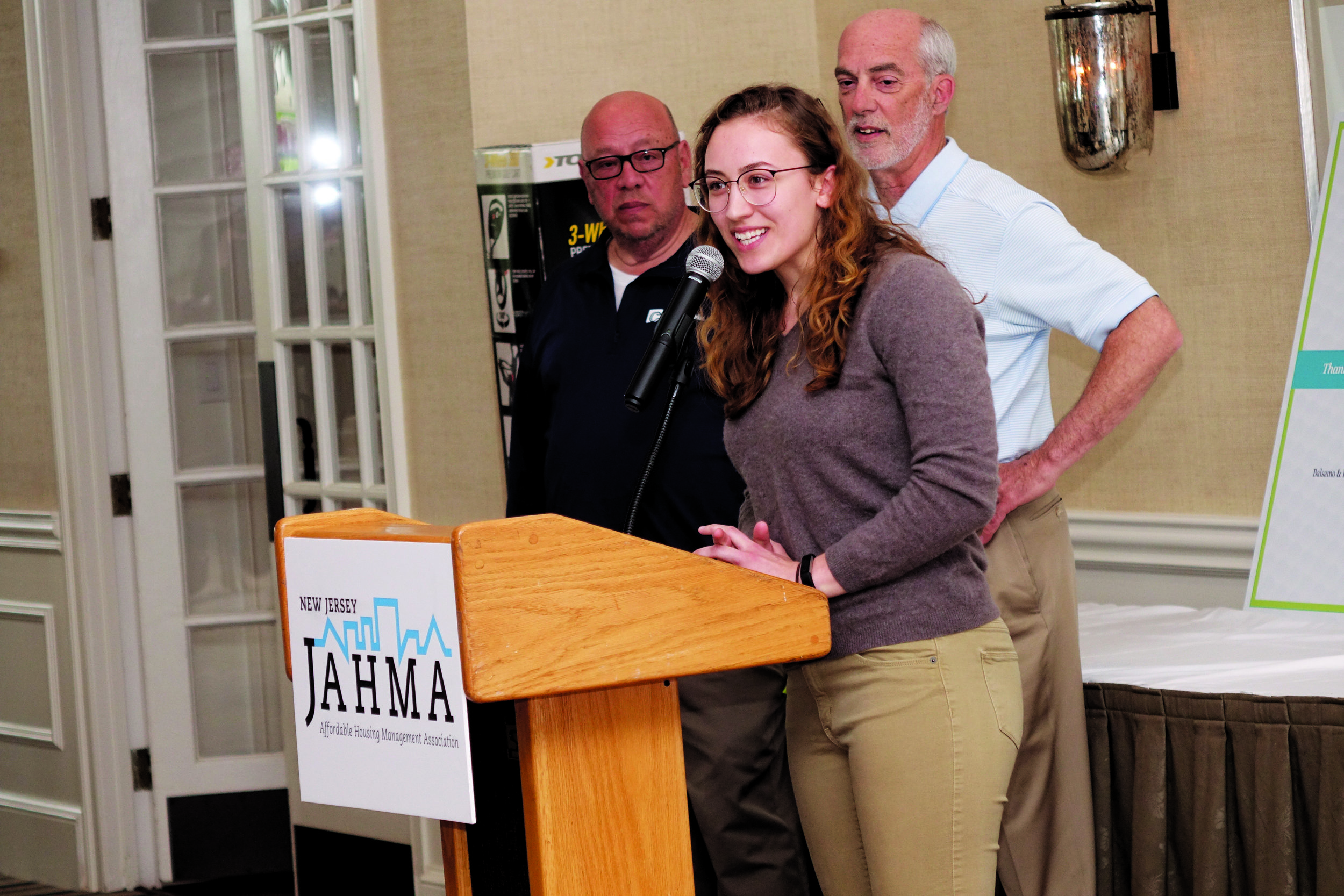 2018 JAHMA Scholar and recent Rutgers University graduate Alana Chmiel speaks to the JAHMA Foundation Golf Outing attendees on May 1 with Ken Pagano and Dr. Bruce Johnson of the foundation in the background.  PHOTO CREDIT: LARRY FALKOW/THE APTS