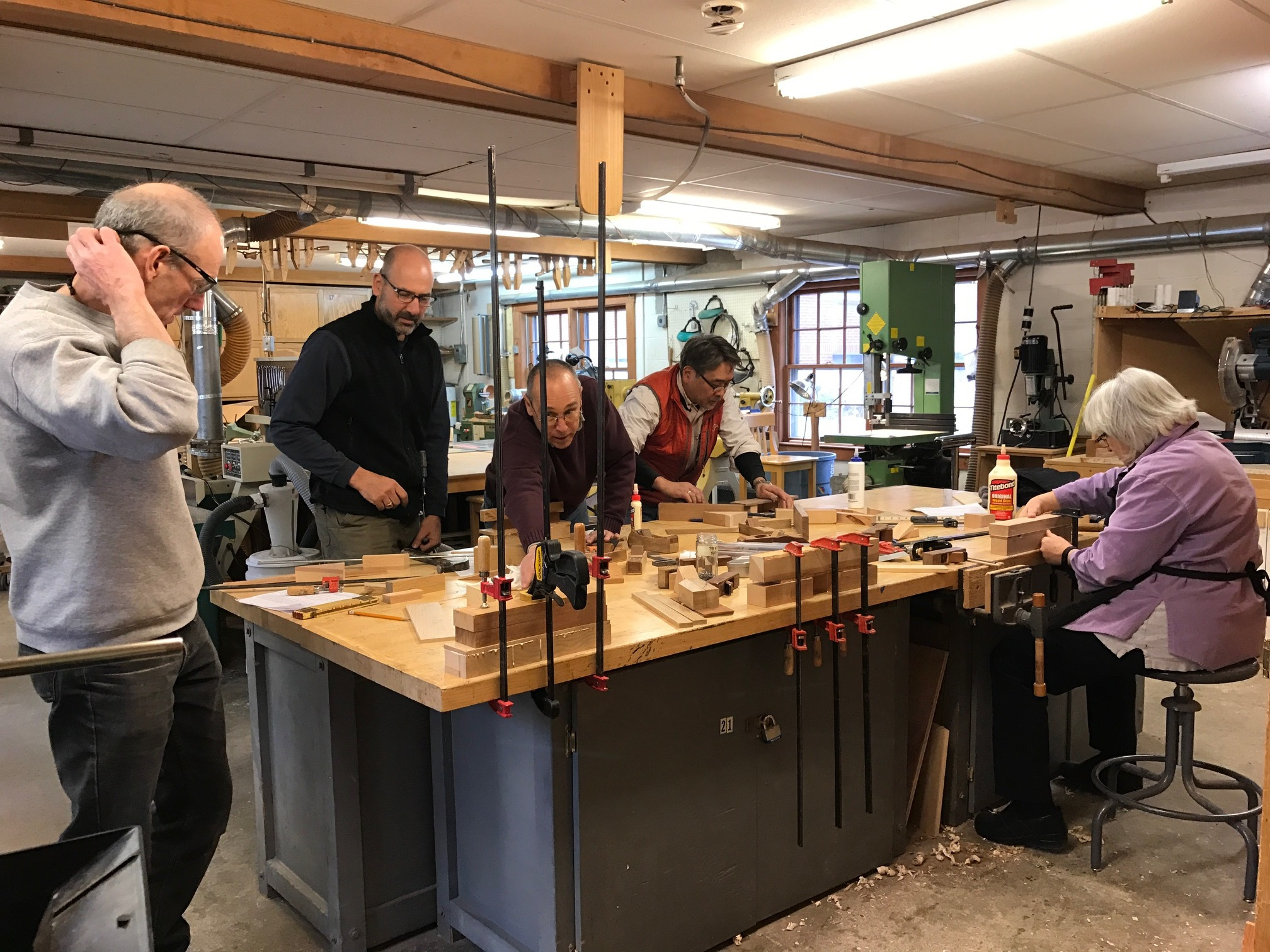 Guild members participating in a  Plane Making Workshop  in the wood shop.