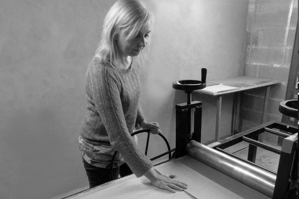 Magda at her printing press.