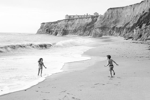 Siblings McKenna and Hudson running free at Three Rocks Beach in Half Moon Bay