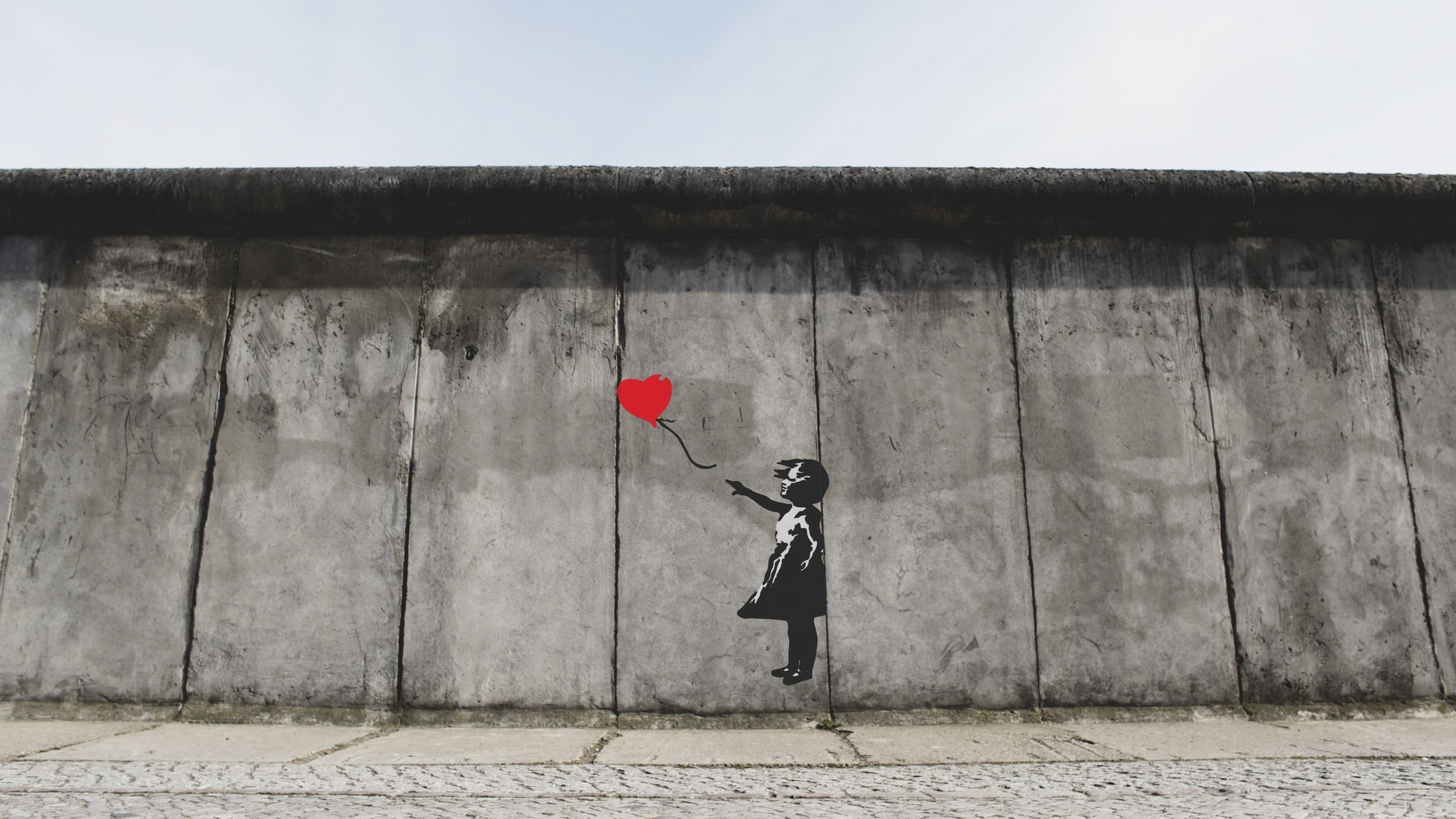 Photo credit to Eric Ward on Unsplash  (and Banksy)