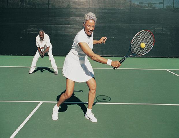 Older_man_woman_playing_tennis.jpg