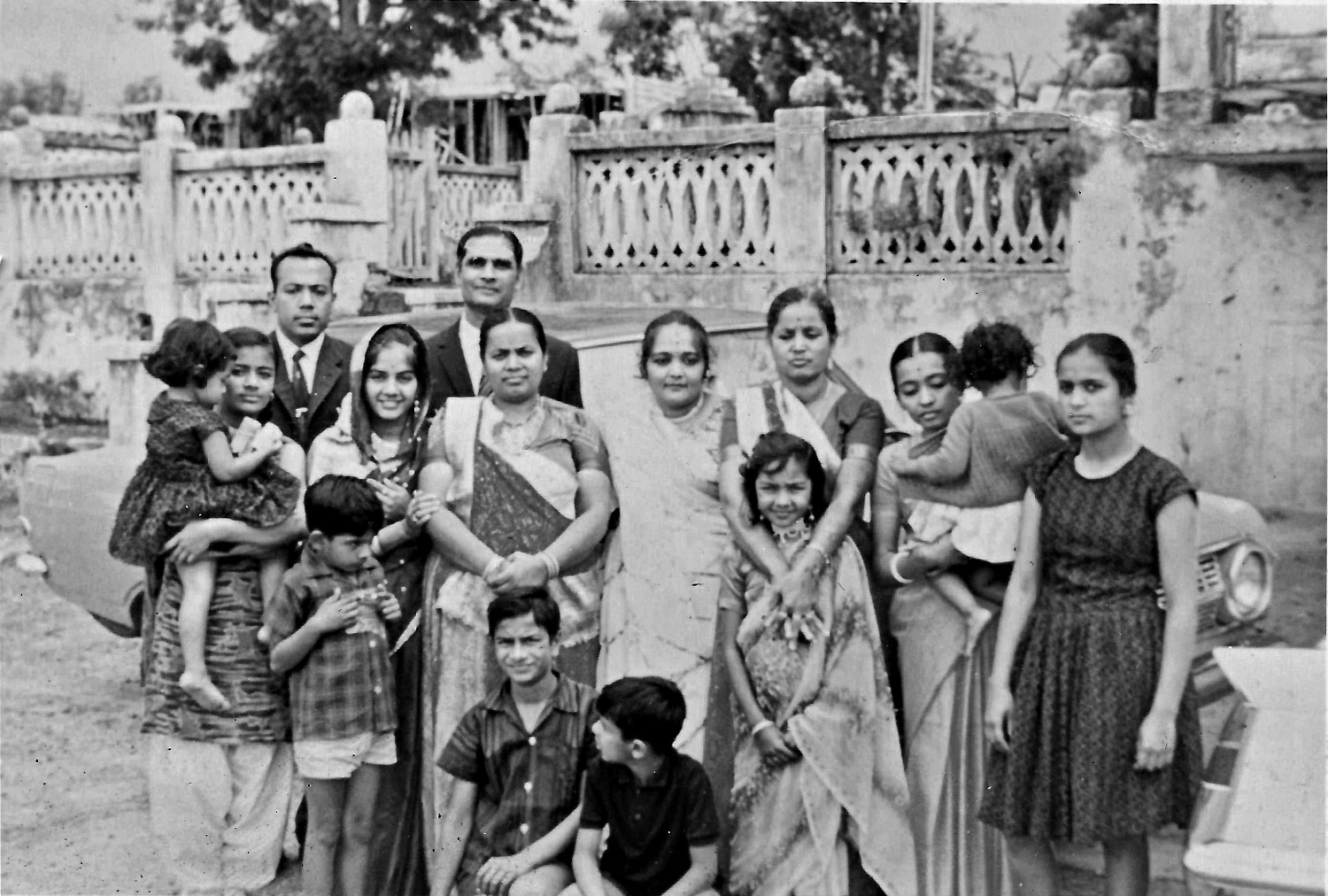 A 1967 photo of Hitesh's family, aunts, uncle and cousins taken at his first home in Nairobi Kenya. Hitesh is seating in the front and wearing a black shirt.
