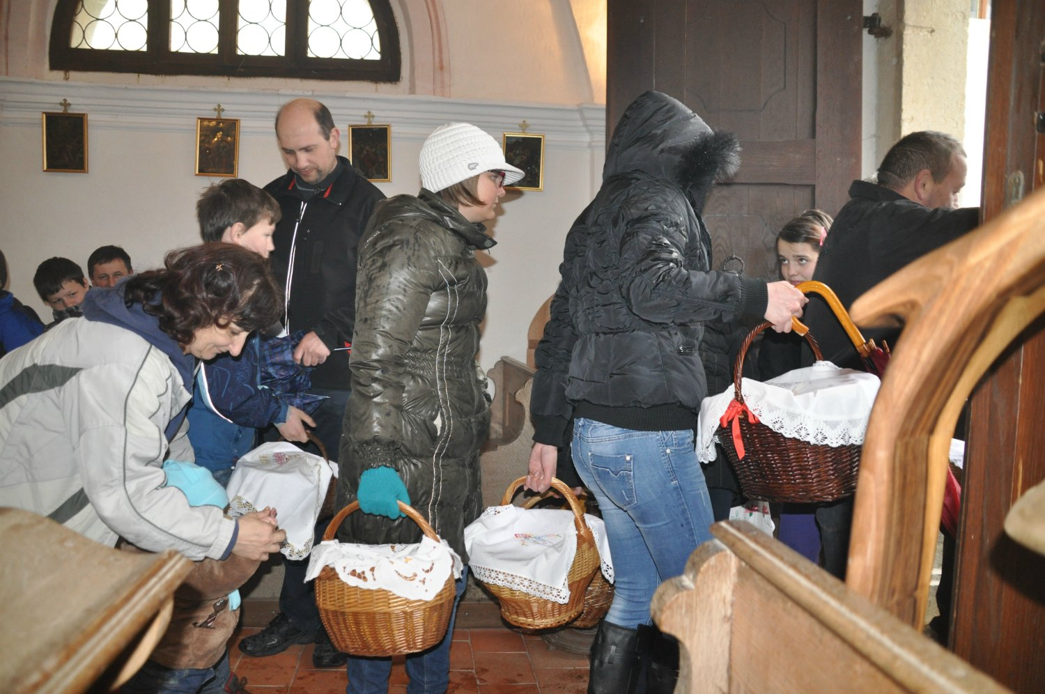 Church-goers leaving with their blessed Easter baskets.