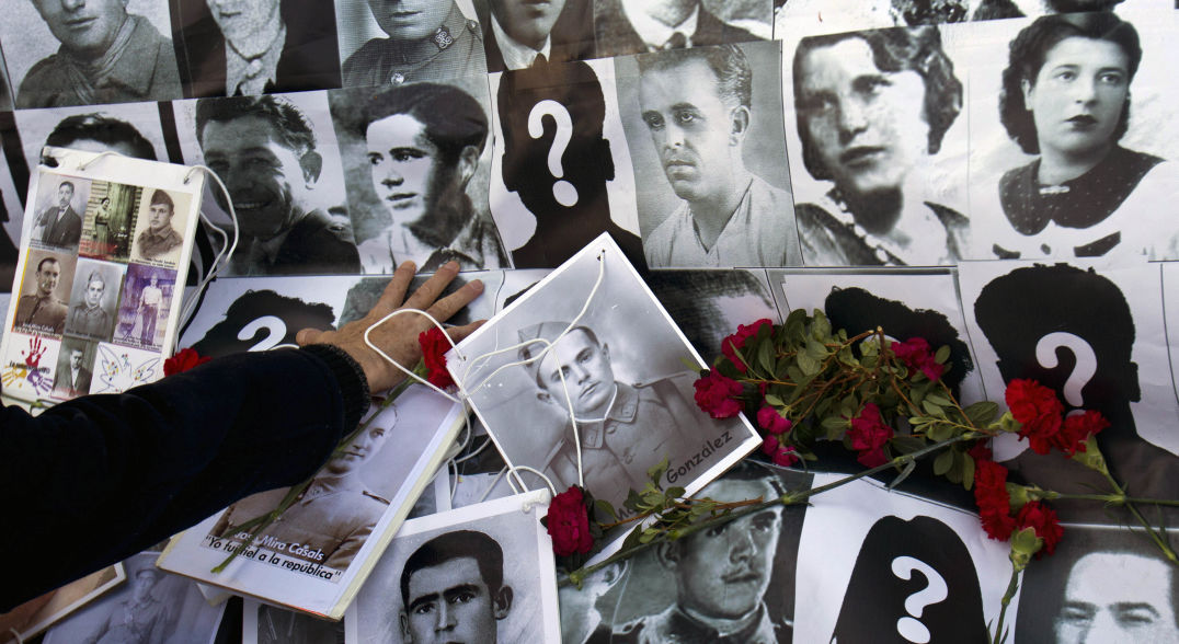 Photos of many soldiers and citizens who died during the Spanish Civil War, which lasted from 1936 to 1939, and have never been recovered. Photo: Paul White/Associated Press