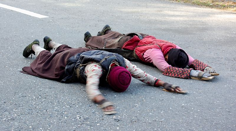 Many of the world's faiths believe pilgrimage involves suffering, penitence & prostration. Photo: Gao (Wikimedia Commons)