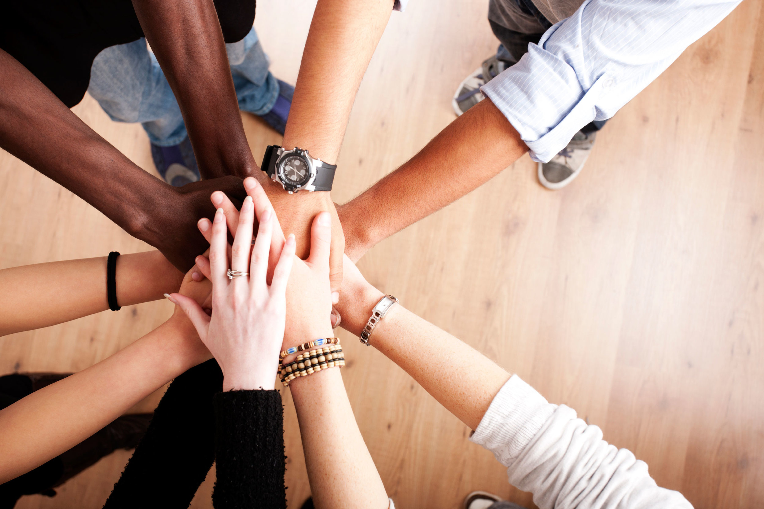 group-with-hands-together-large.jpg