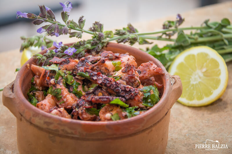 Fried octopus with freshly chopped parsley. Photo credit: Pierre Balzia