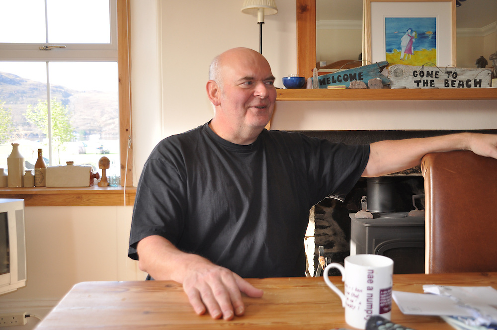 Richard sat in his spacious kitchen. Photo: Meg Pier